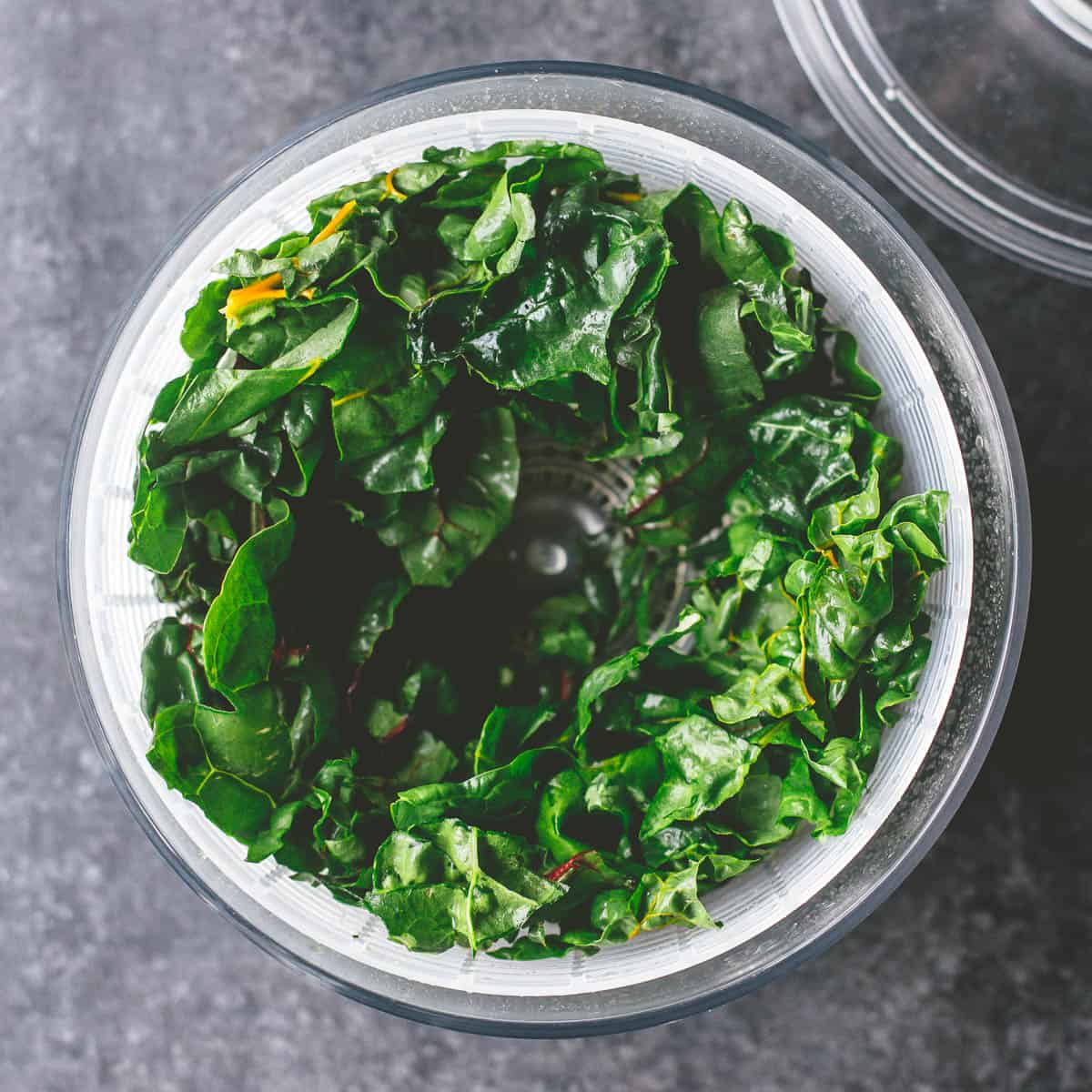 mixed greens in a salad spinner