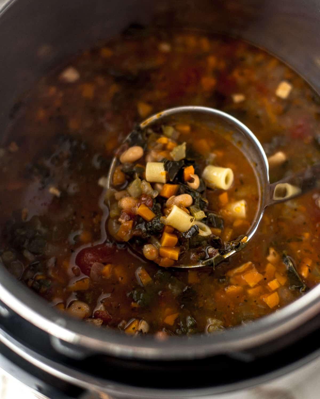 a ladle of pasta e fagioli soup