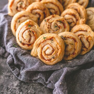cheese pinwheels in a towel lined basket