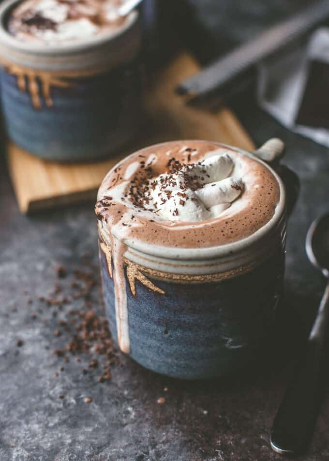 hot chocolate topped with whipped cream in a blue mug