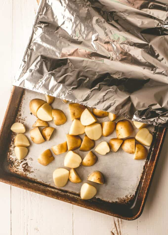 diced potatoes on a sheet pan covered in foil
