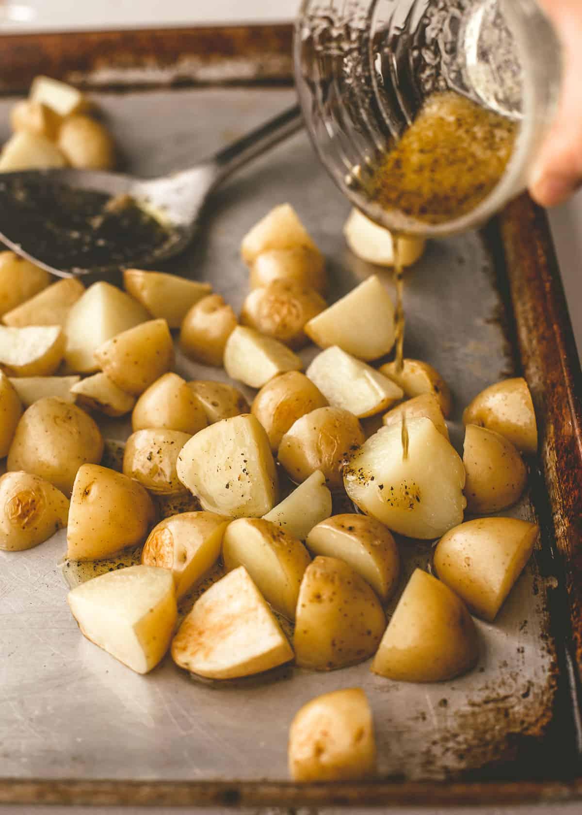 adding seasoning mix to cut potatoes