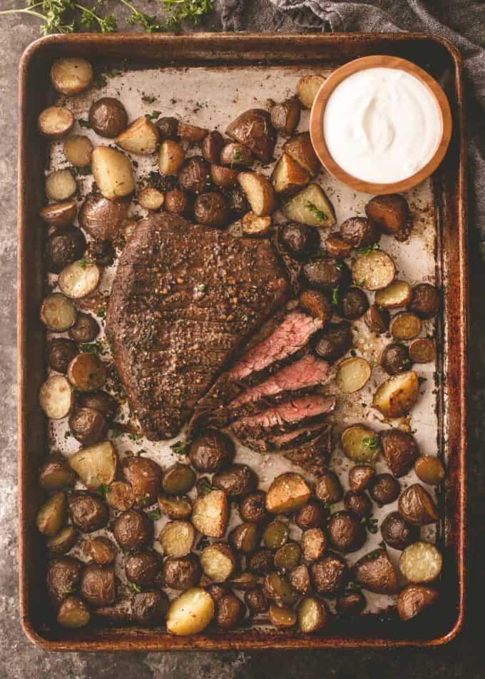 steak and potatoes on a sheet pan