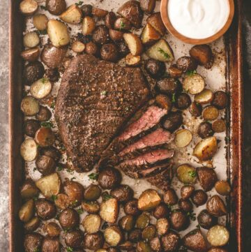 steak and potatoes on a sheet pan