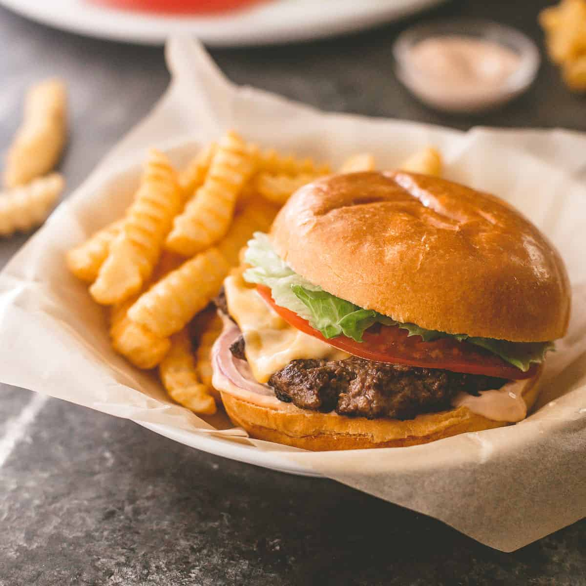 burger and fries in a paper lined basket