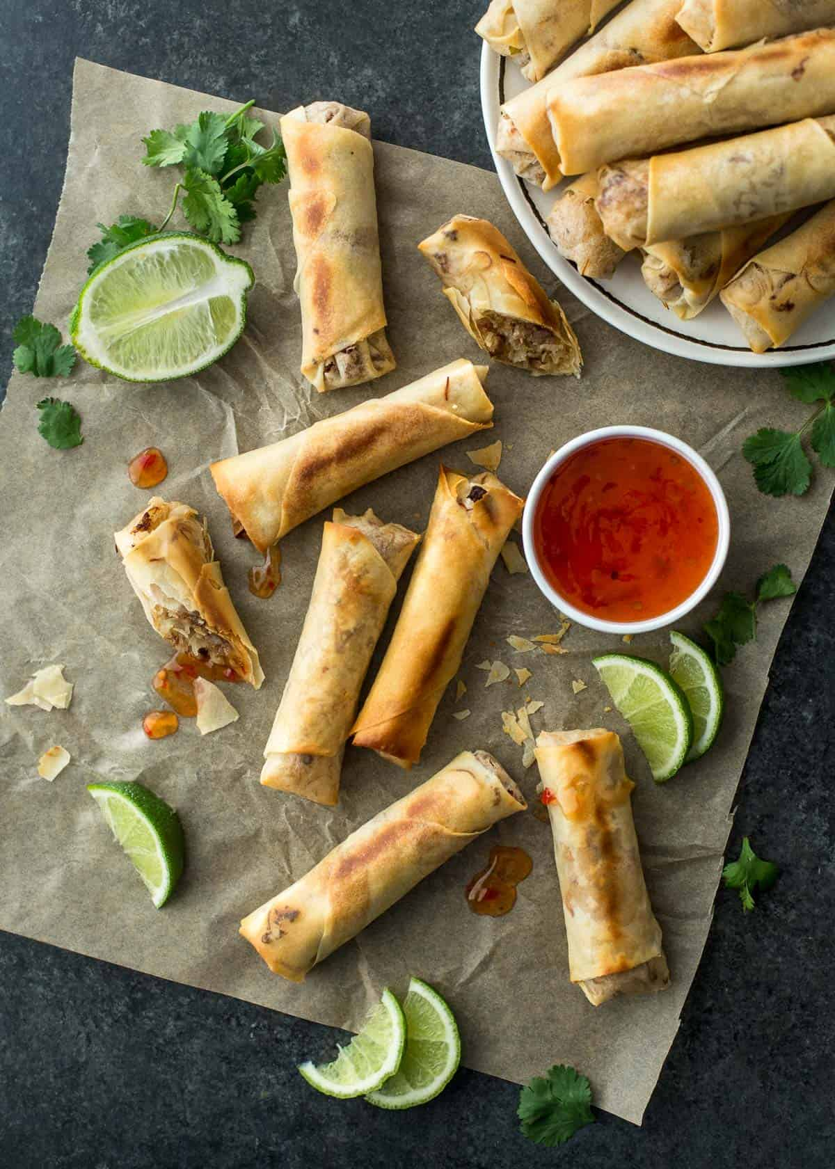 spring rolls and sauce on a sheet pan