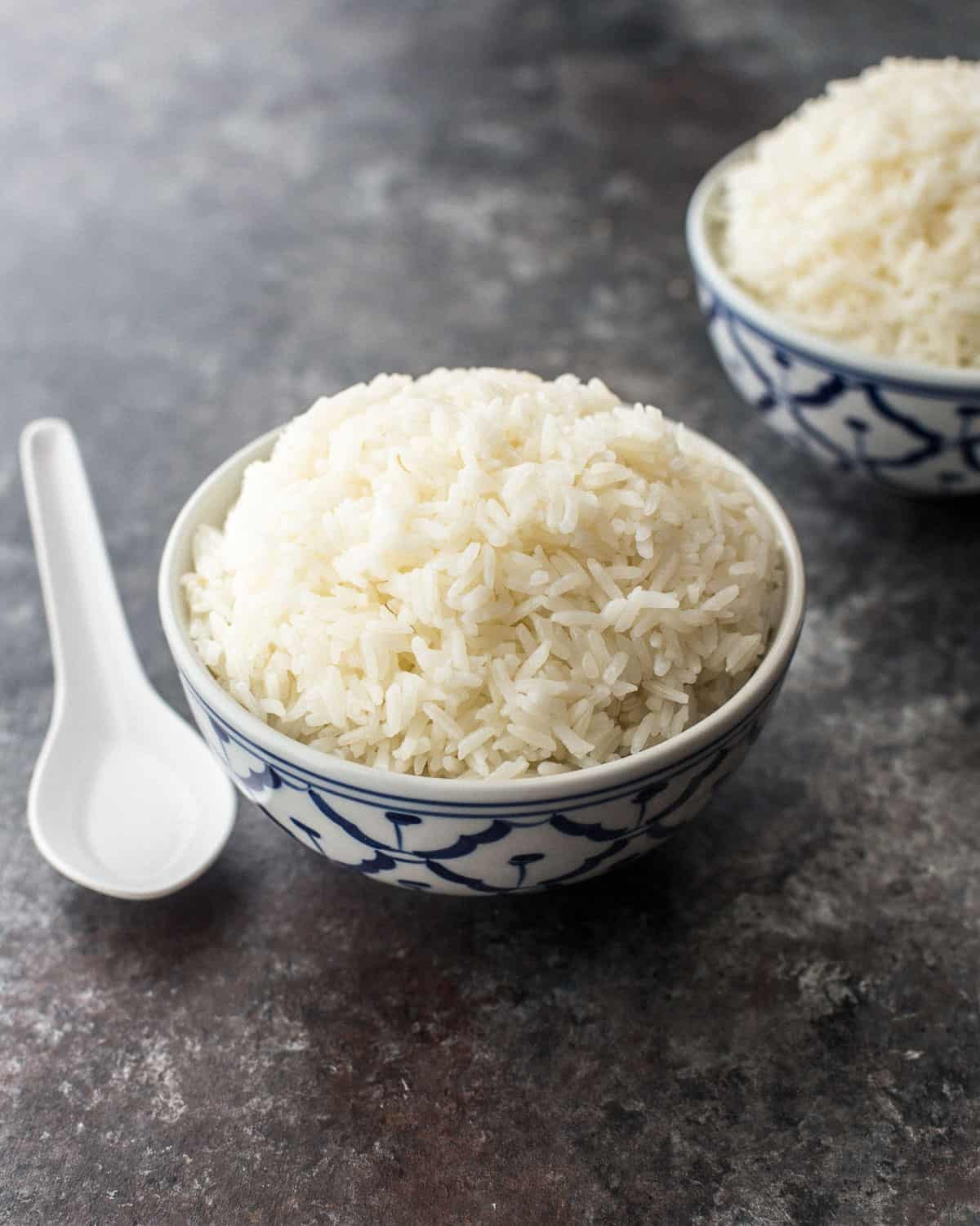 a bowl of jasmine rice on a grey countertop
