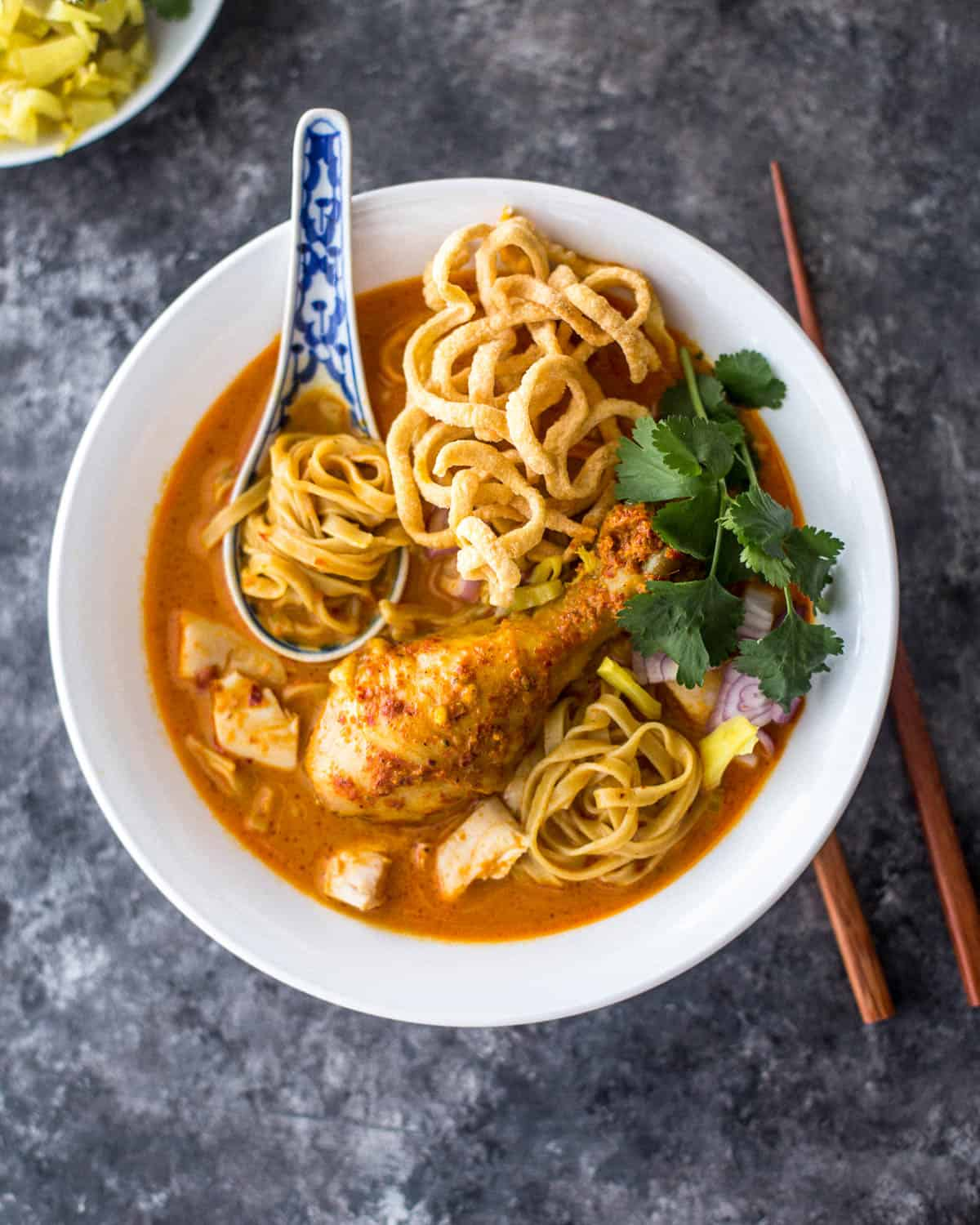 chiang mai noodles in a white bowl