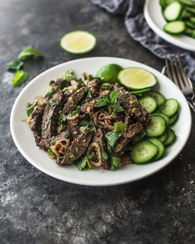 Thai beef salad on a white plate