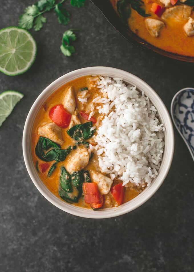 coconut chicken curry in a white bowl with rice