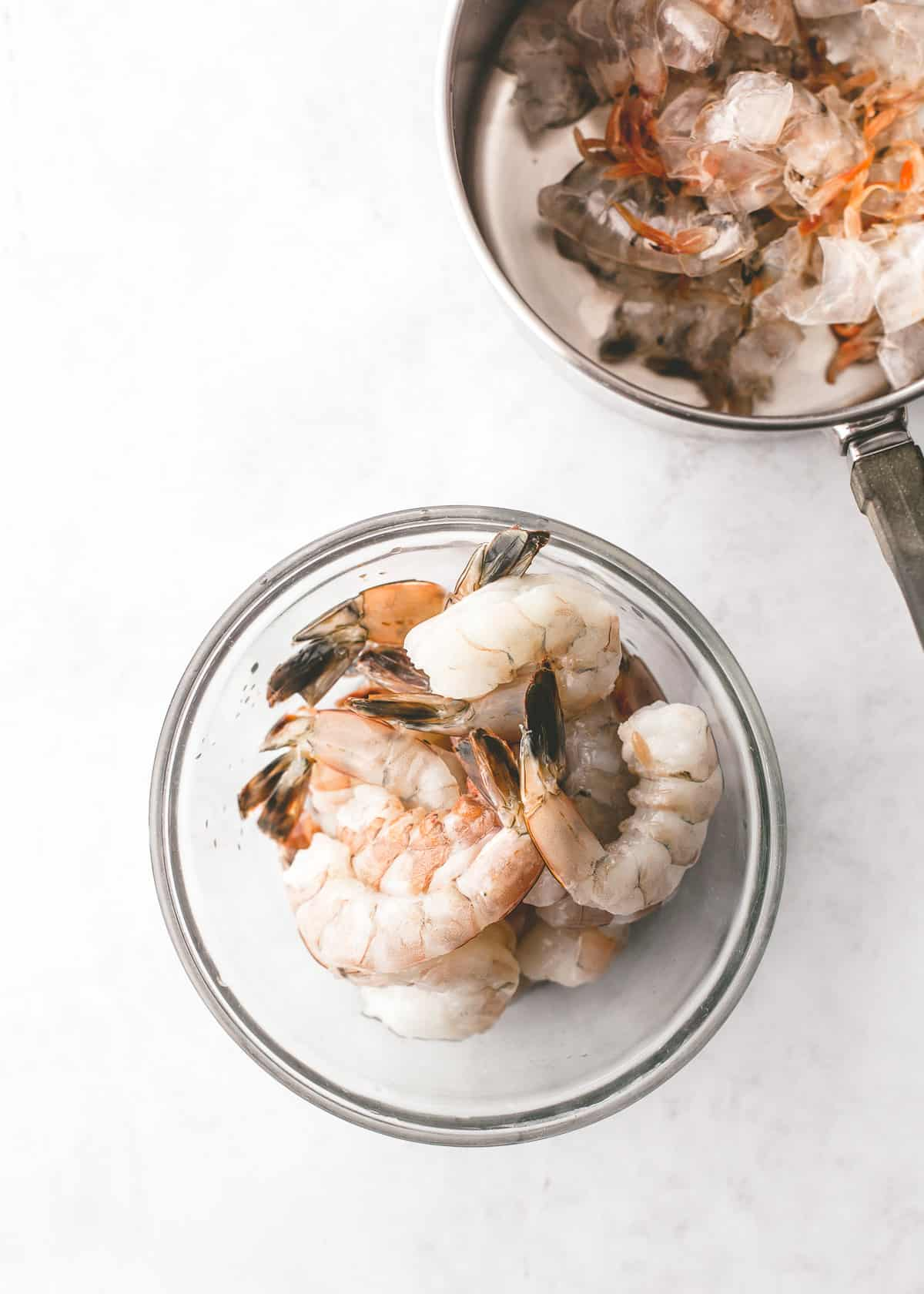 uncooked shrimp in a clear bowl