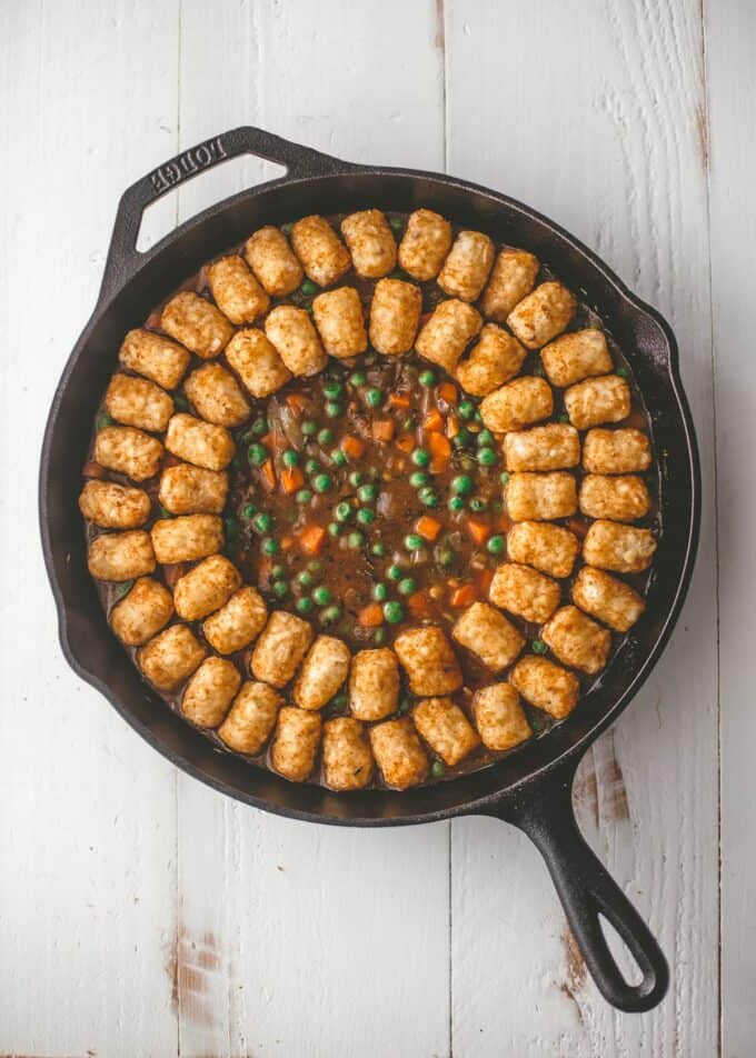 lining a cast iron skillet with tater tots
