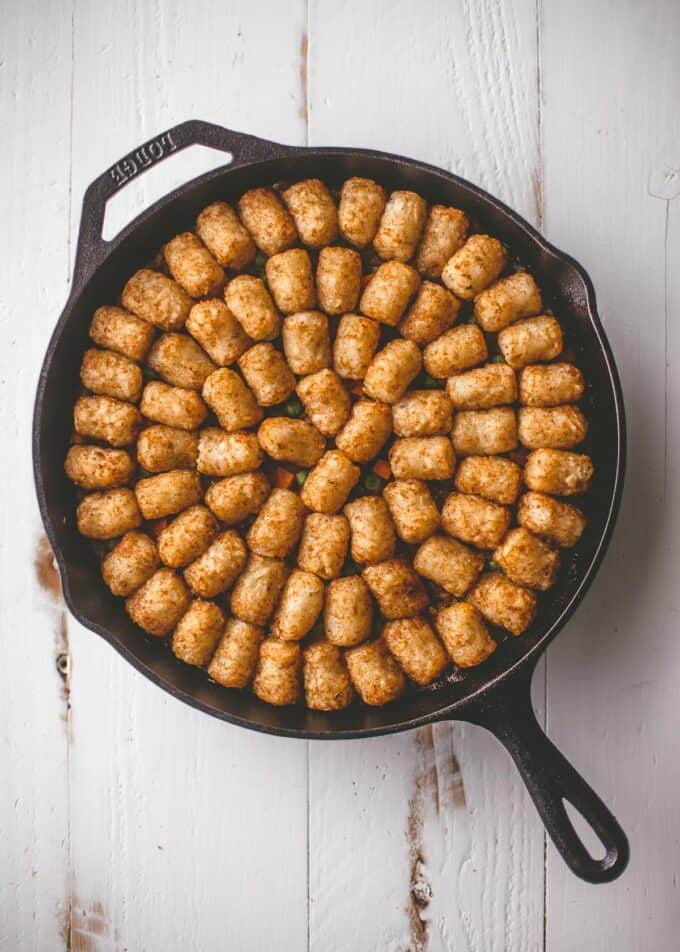 tater tot casserole in a cast iron skillet