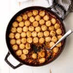 vegetarian tater tot casserole in a cast iron skillet