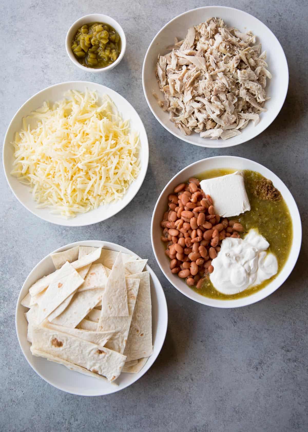 ingredients for chicken casserole in white bowls