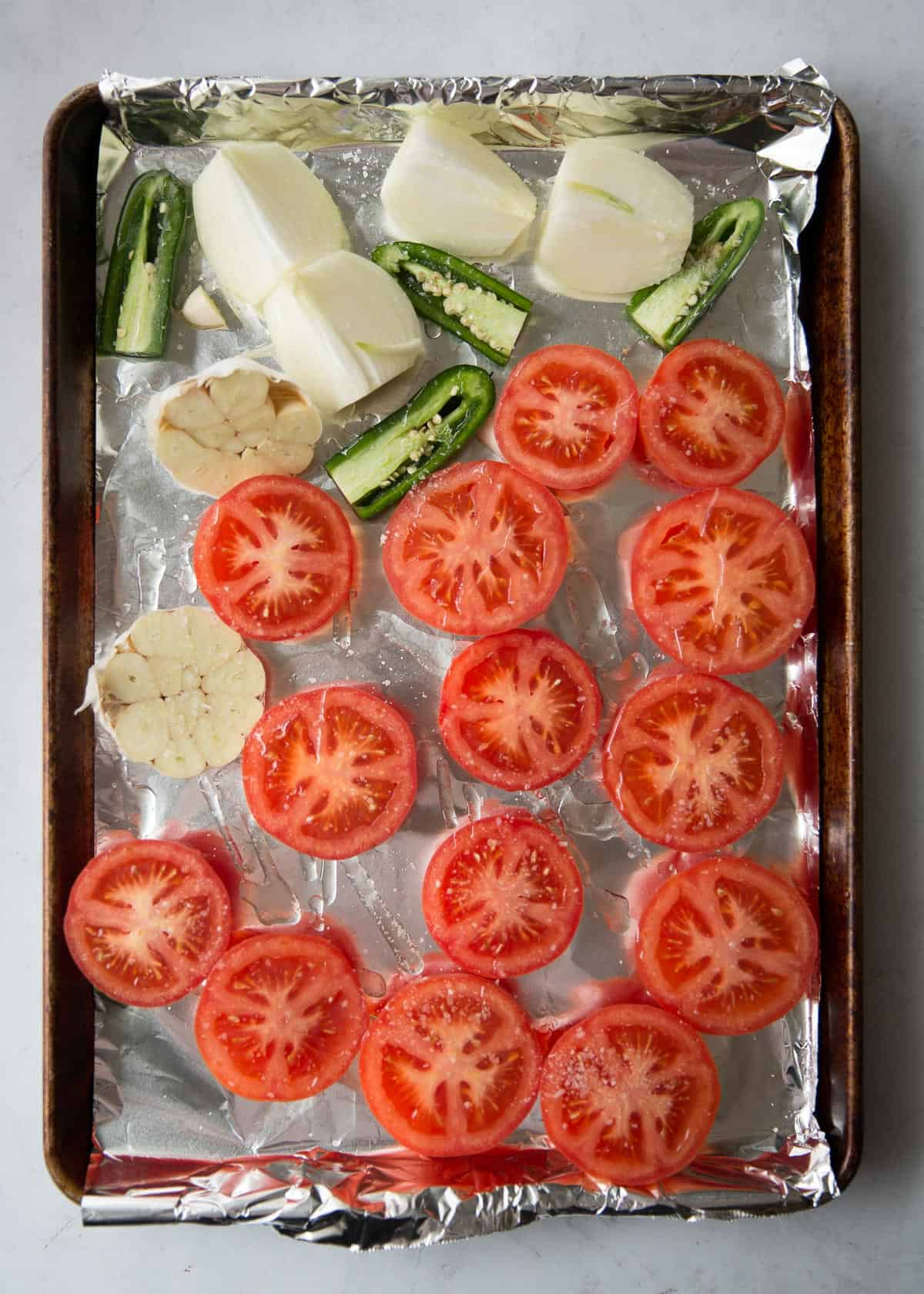 roasting vegetables on a foil lined sheet pan