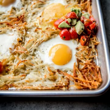 eggs, potatoes and salsa on a sheet pan