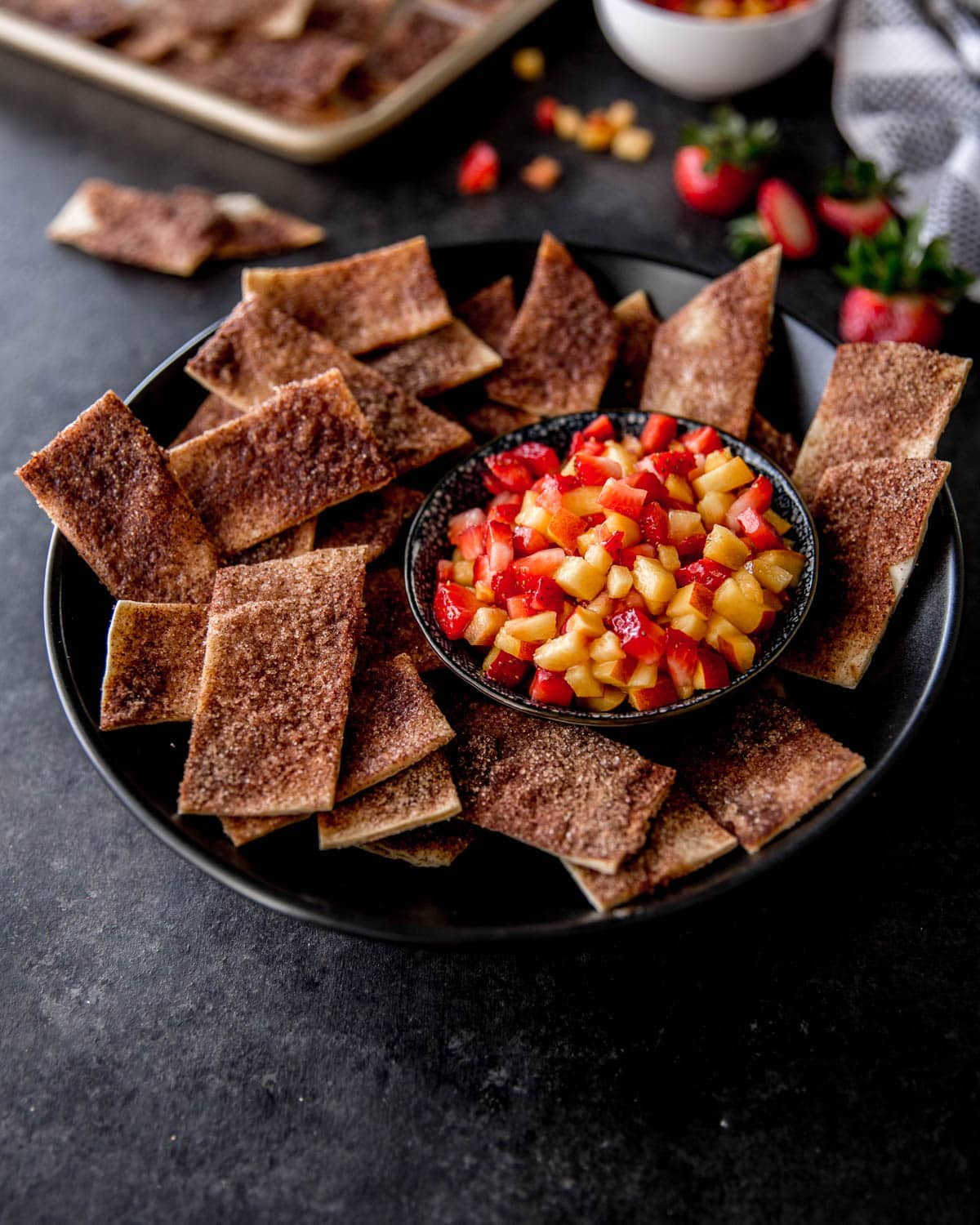 salsa and cinnamon chips in a black bowl