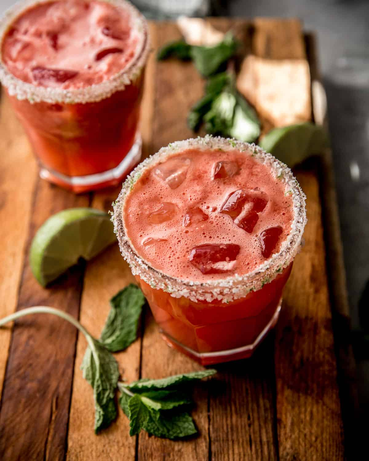 watermelon margaritas in a clear glass on a wooden table