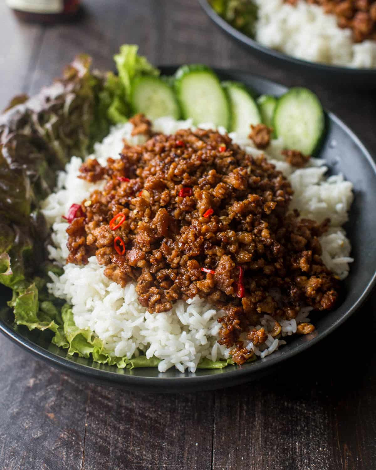 pork and rice bowls with cucumbers and lettuce