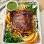 blackened salmon on sheet pan with citrus slices