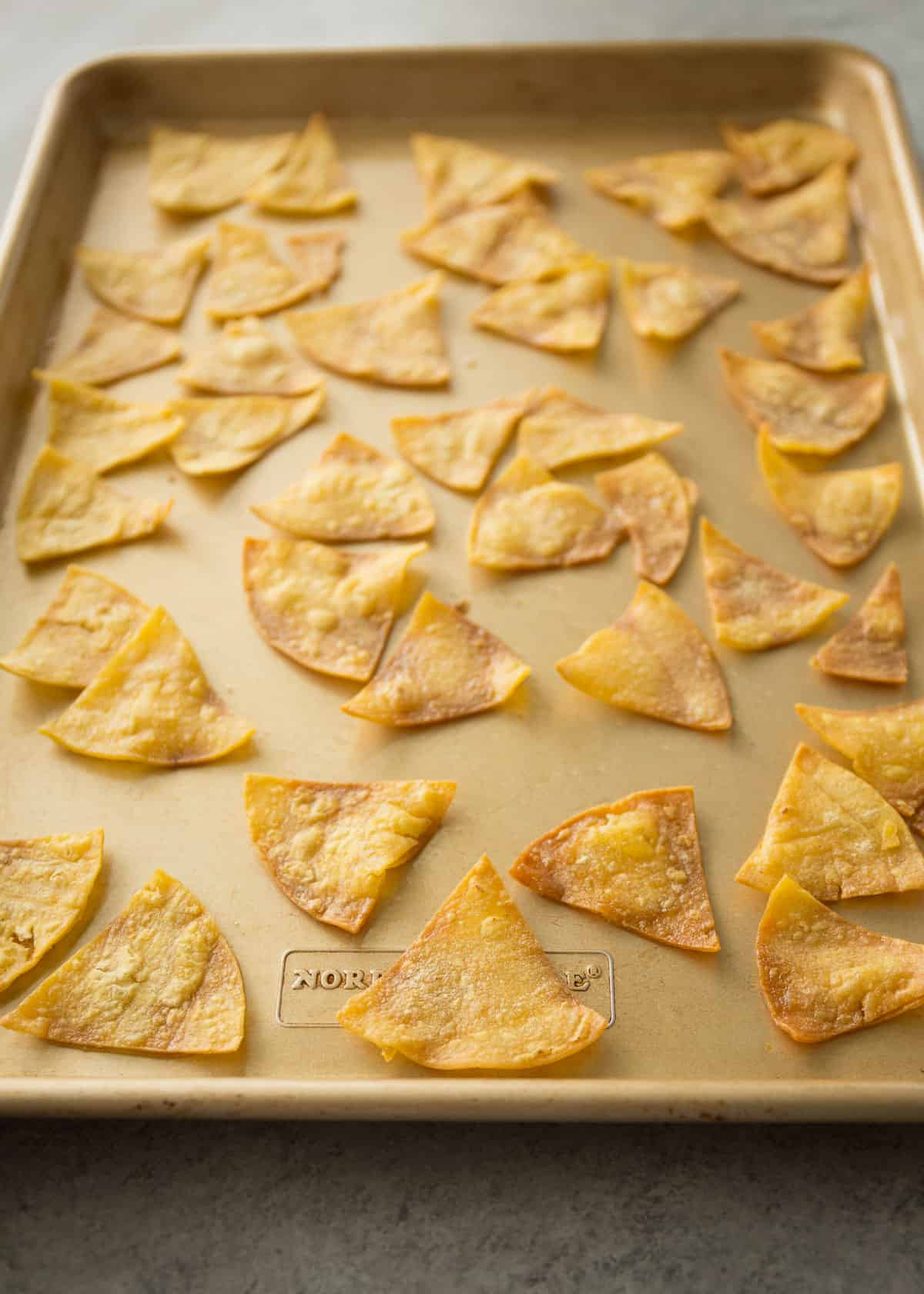 baking tortilla chips on a sheet pan