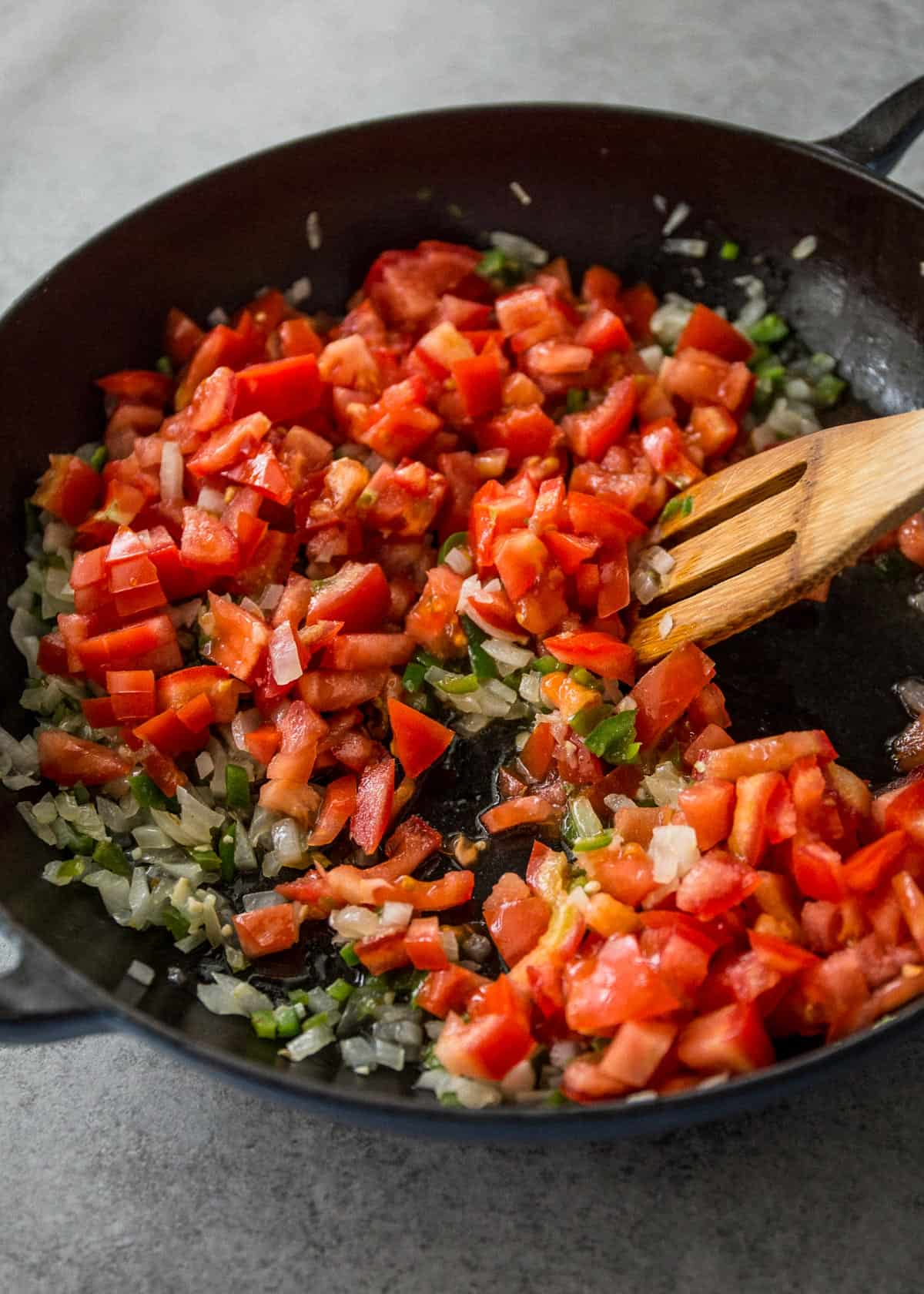 tomatoes and herbs in a cast iron skillet