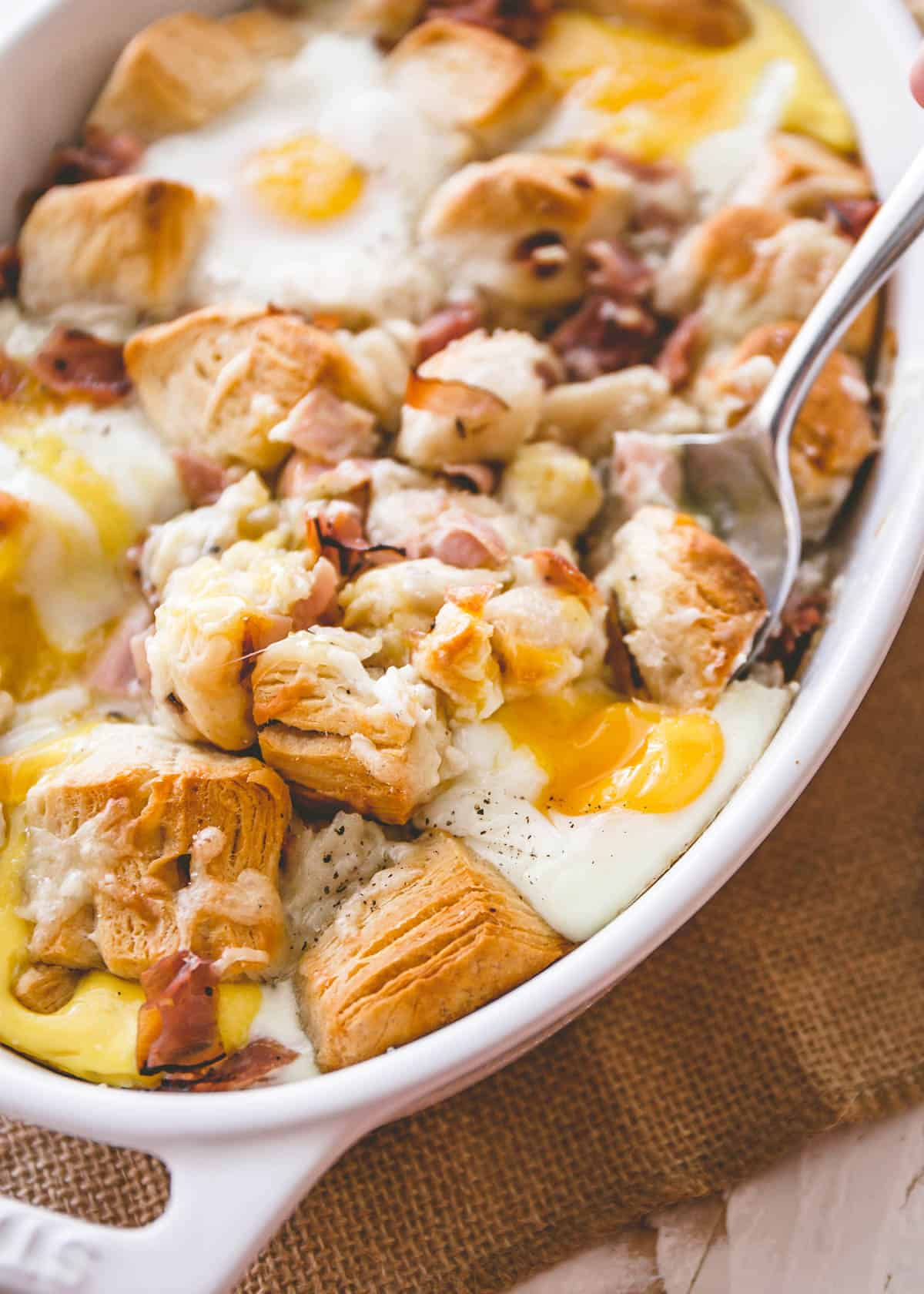 ham and cheese bake in a white baking dish