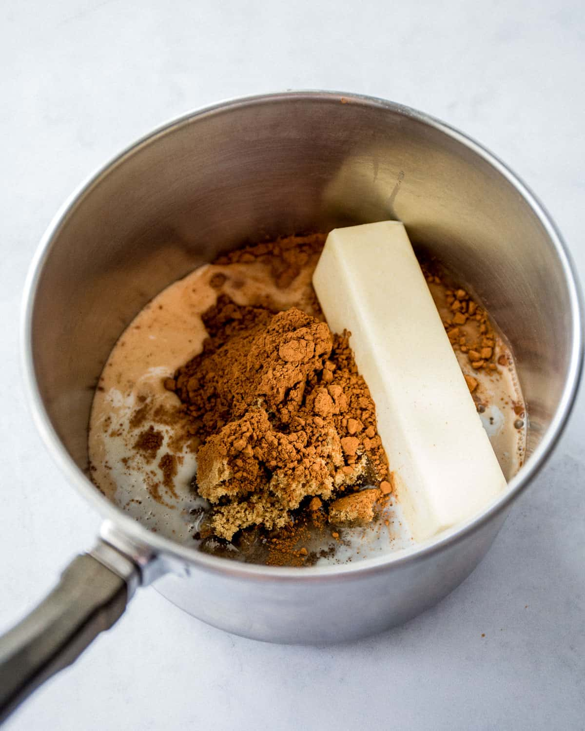 brown sugar and a stick of butter in a saucepan