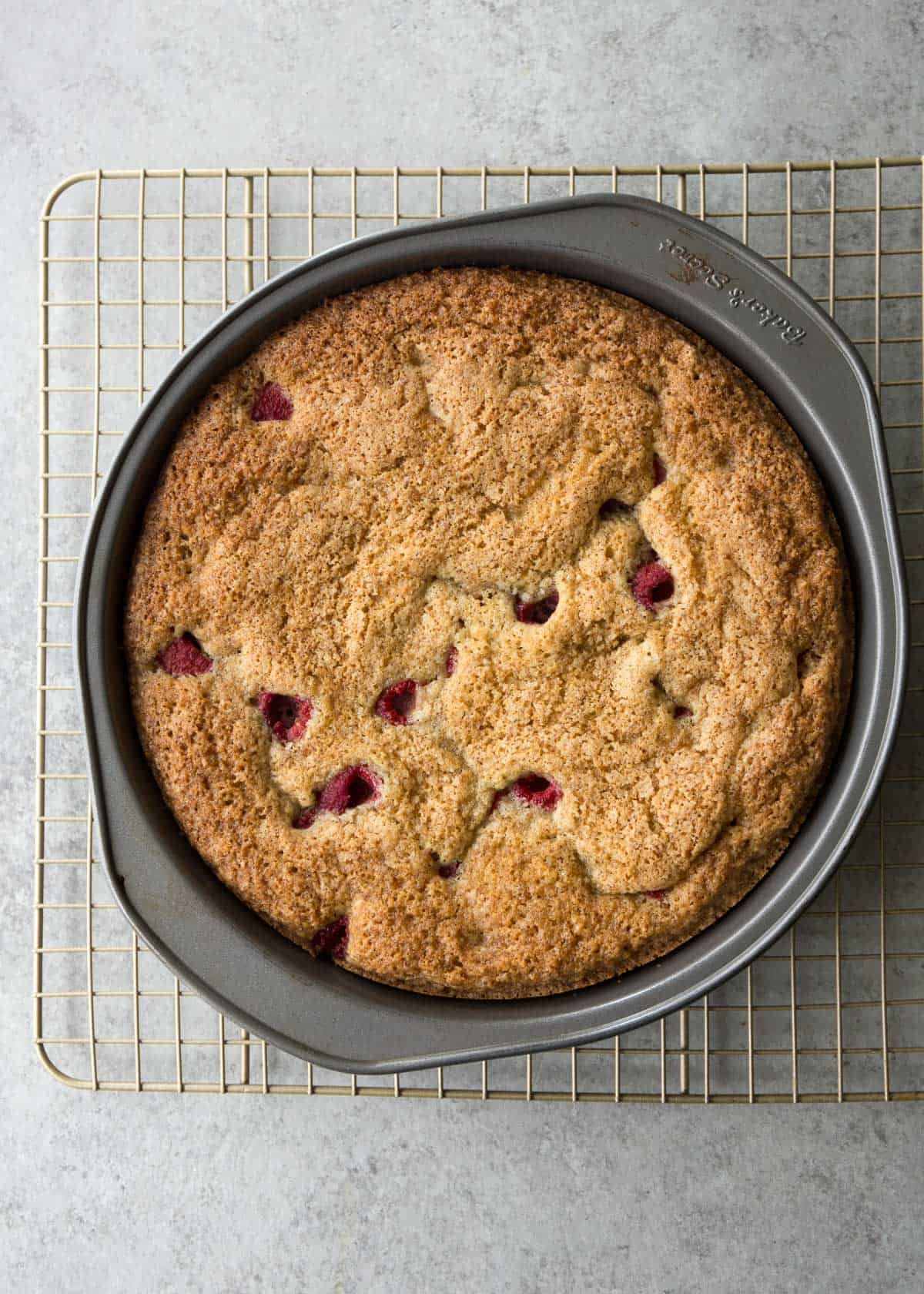 raspberry snack cake in a round cake pan