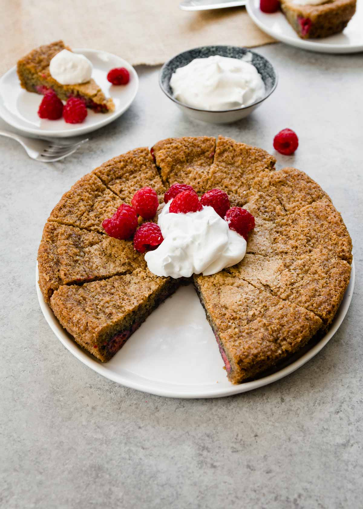 raspberry almond cake with a slice removed