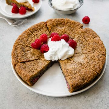 square raspberry almond cake with a slice removed
