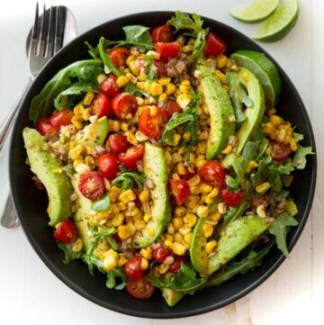summer salad in a black bowl