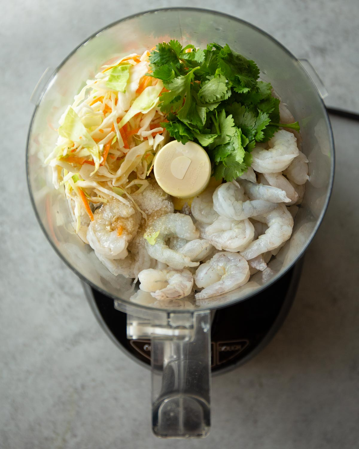 shrimp and herbs in a food processor