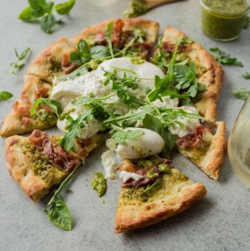 a homemade pizza on a grey countertop