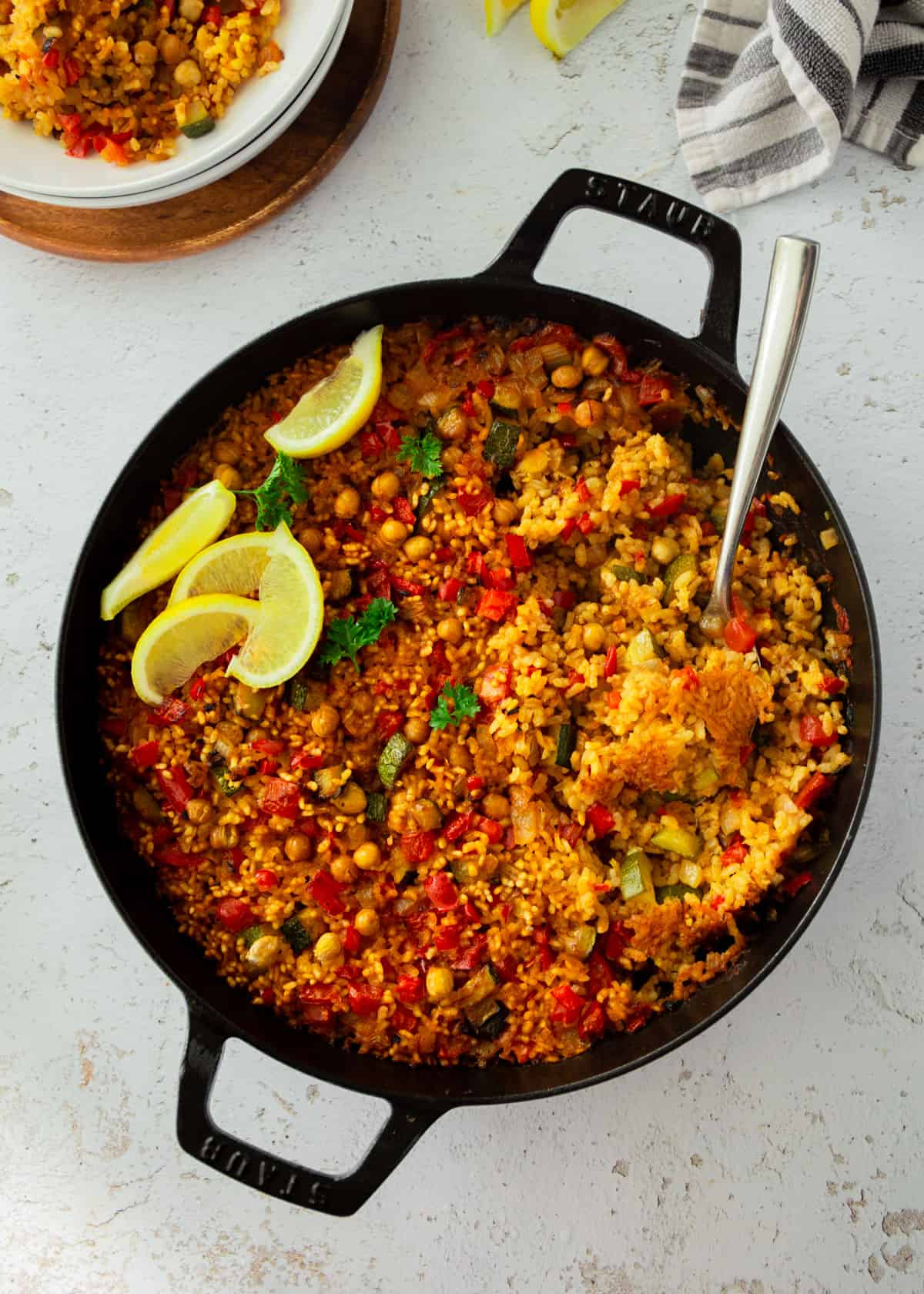 a spoon in a skillet of paella