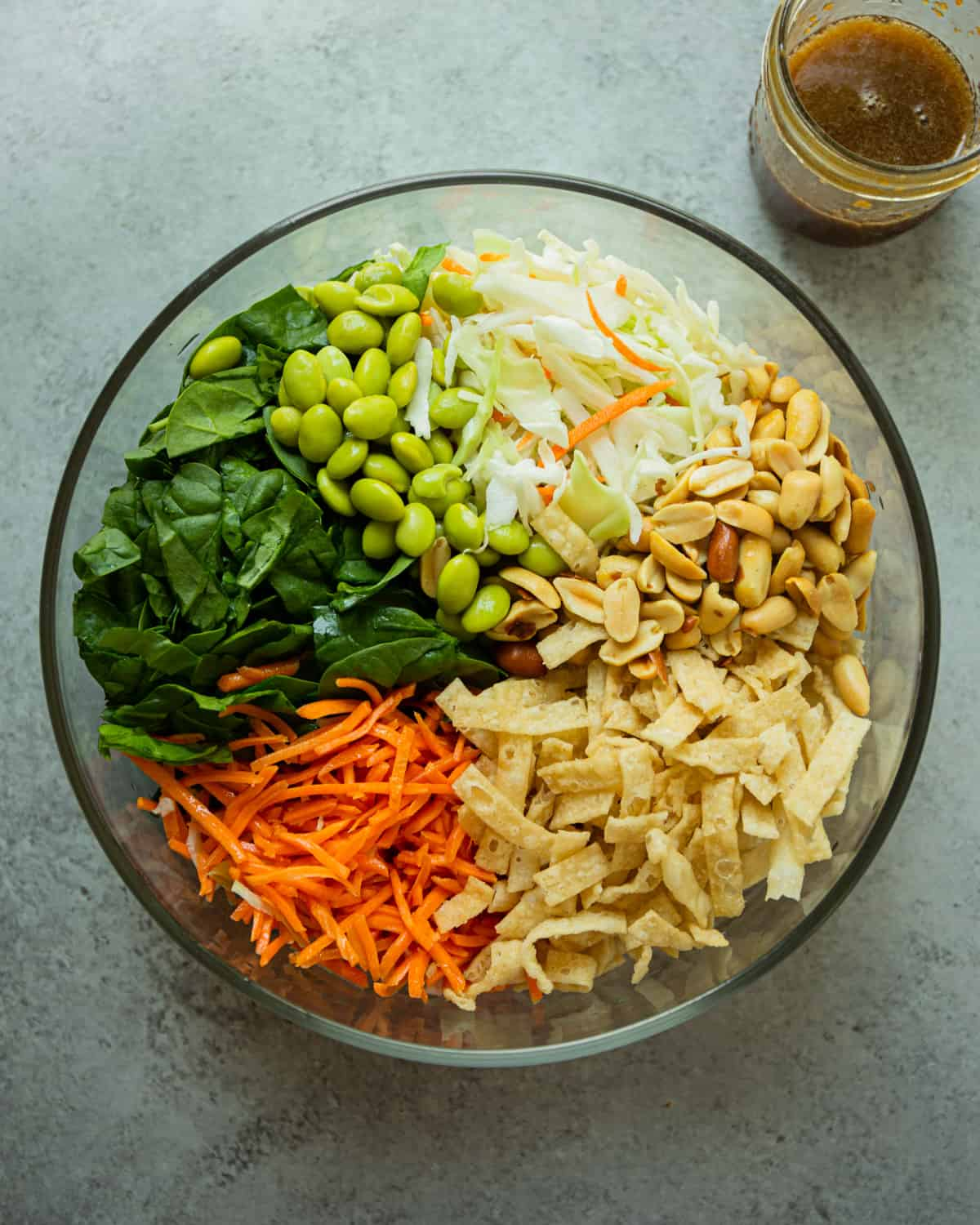 ingredients for Asian chopped salad in a clear glass bowl