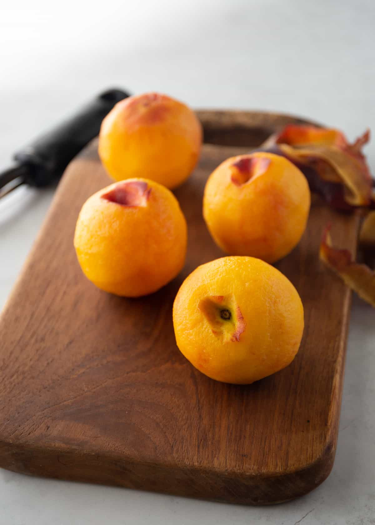 peaches on a wooden cutting board