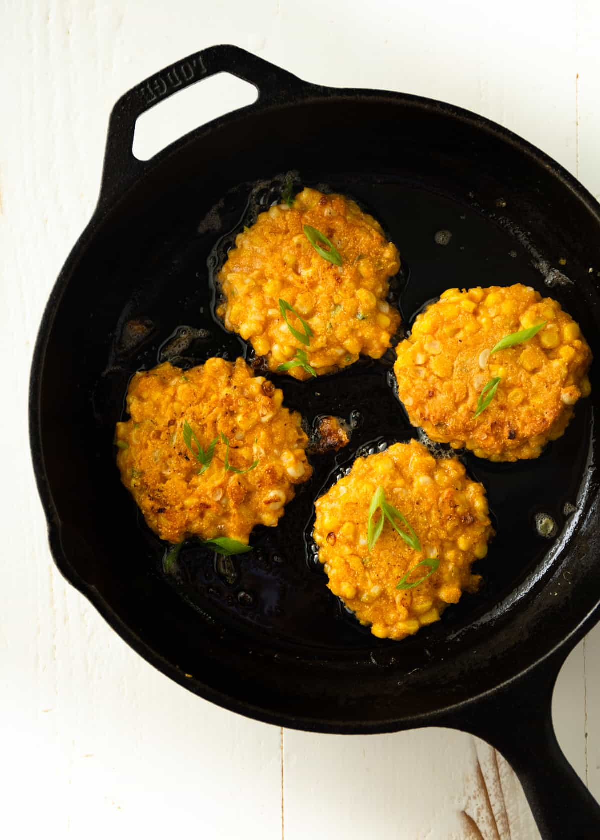 fritters in a cast iron skillet