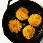 corn fritters in a cast iron skillet