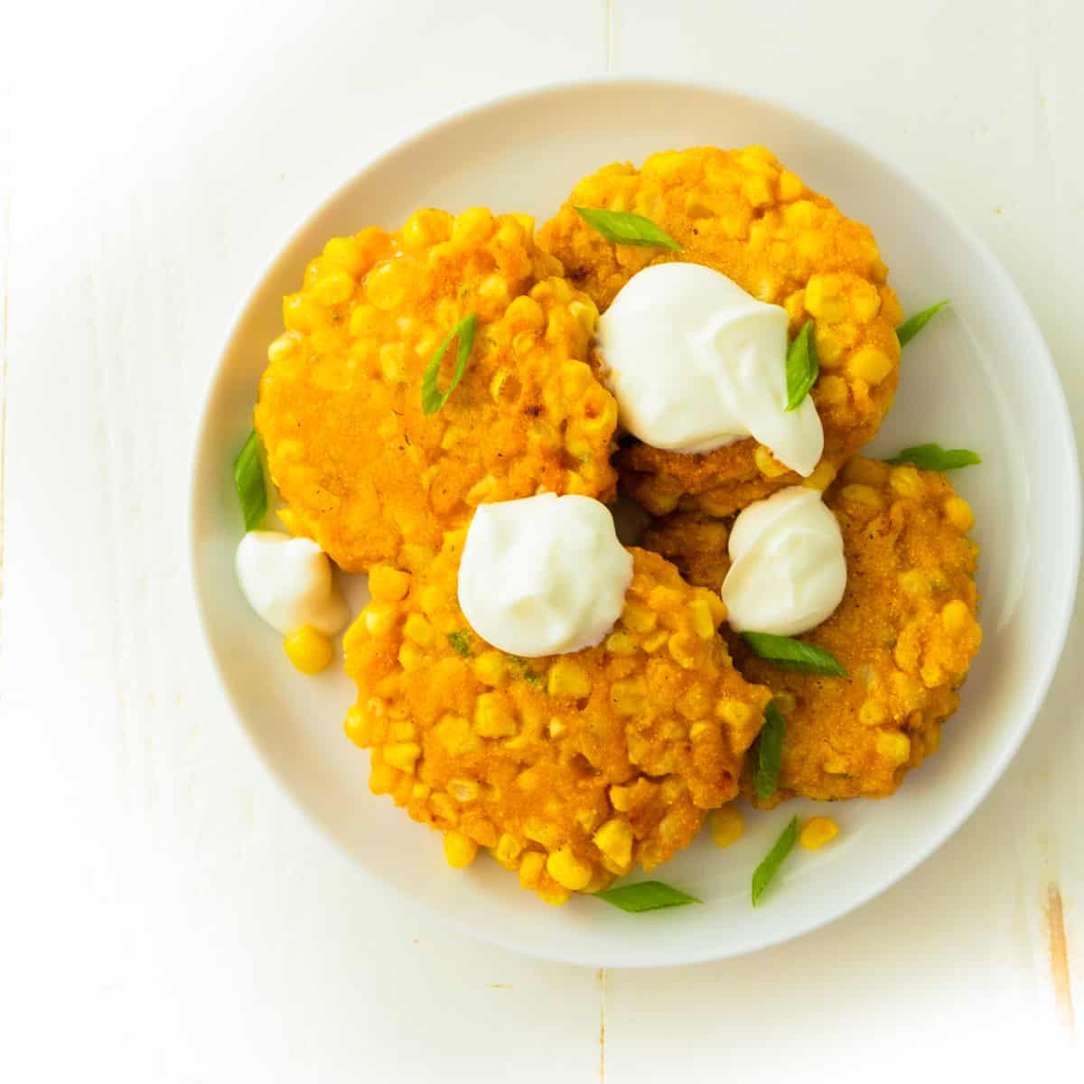 corn fritters on a white plate