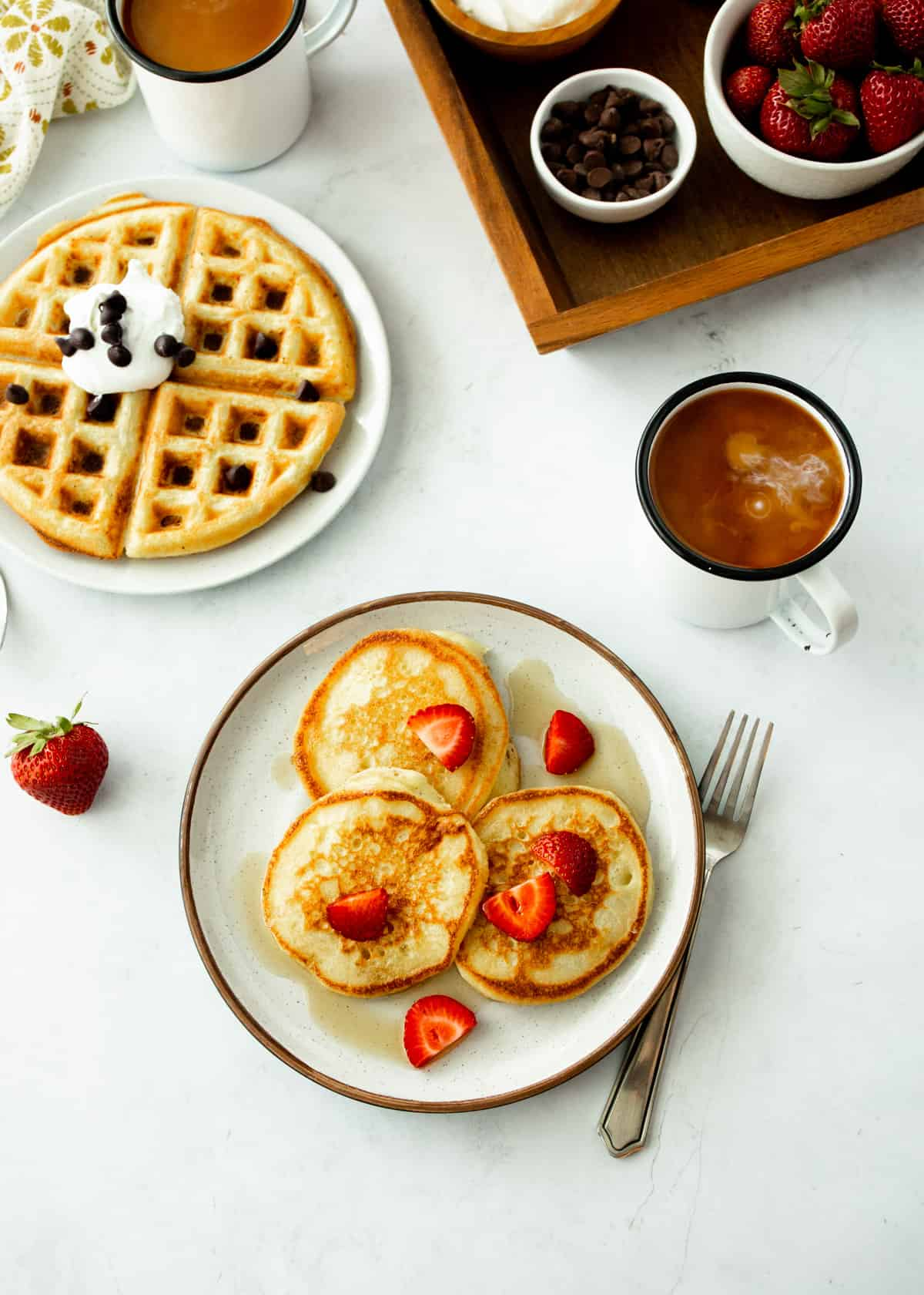 pancakes and waffles on white plates