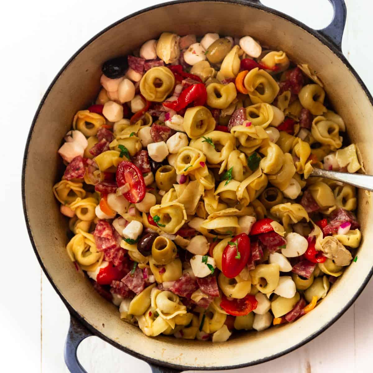 pasta salad in a blue dutch oven