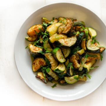 cooked zucchini in a white bowl