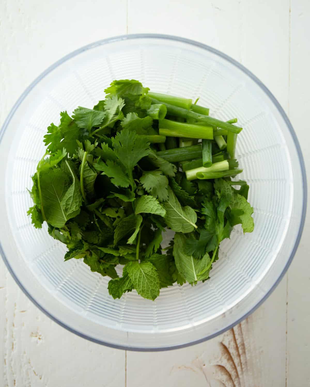 chopped herbs in a clear bowl