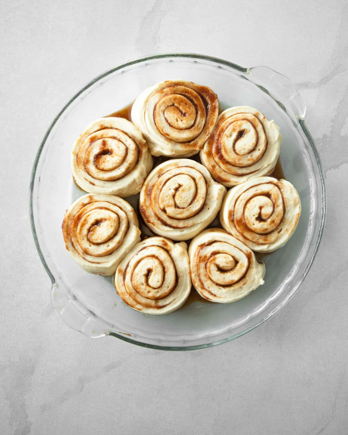 uncooked rolls in a clear baking dish