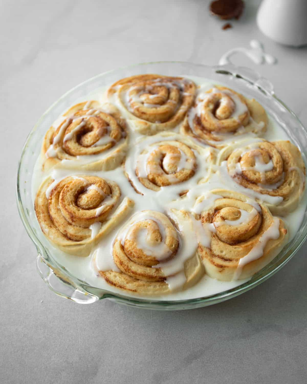 cinnamon rolls in a round clear baking dish