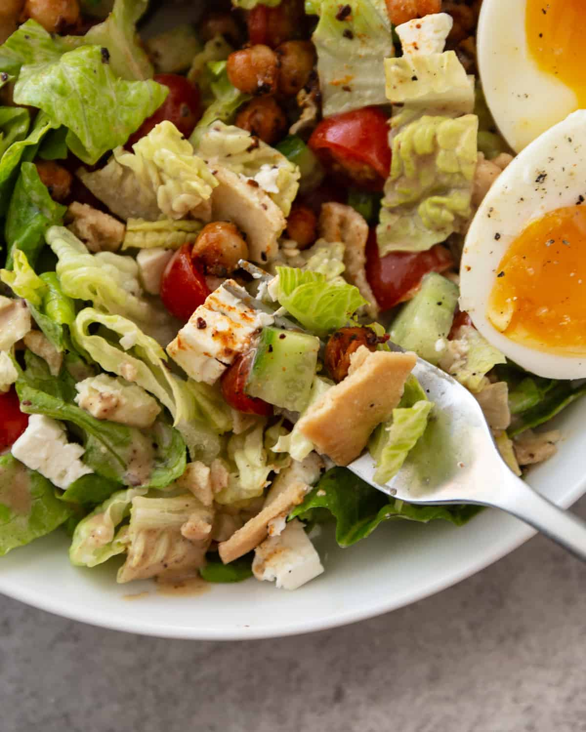 a fork in a bowl of fattoush salad
