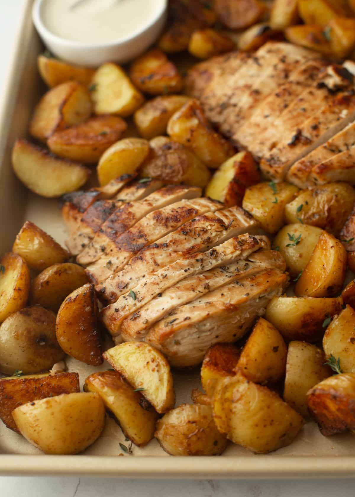 chicken and potatoes on a sheet pan