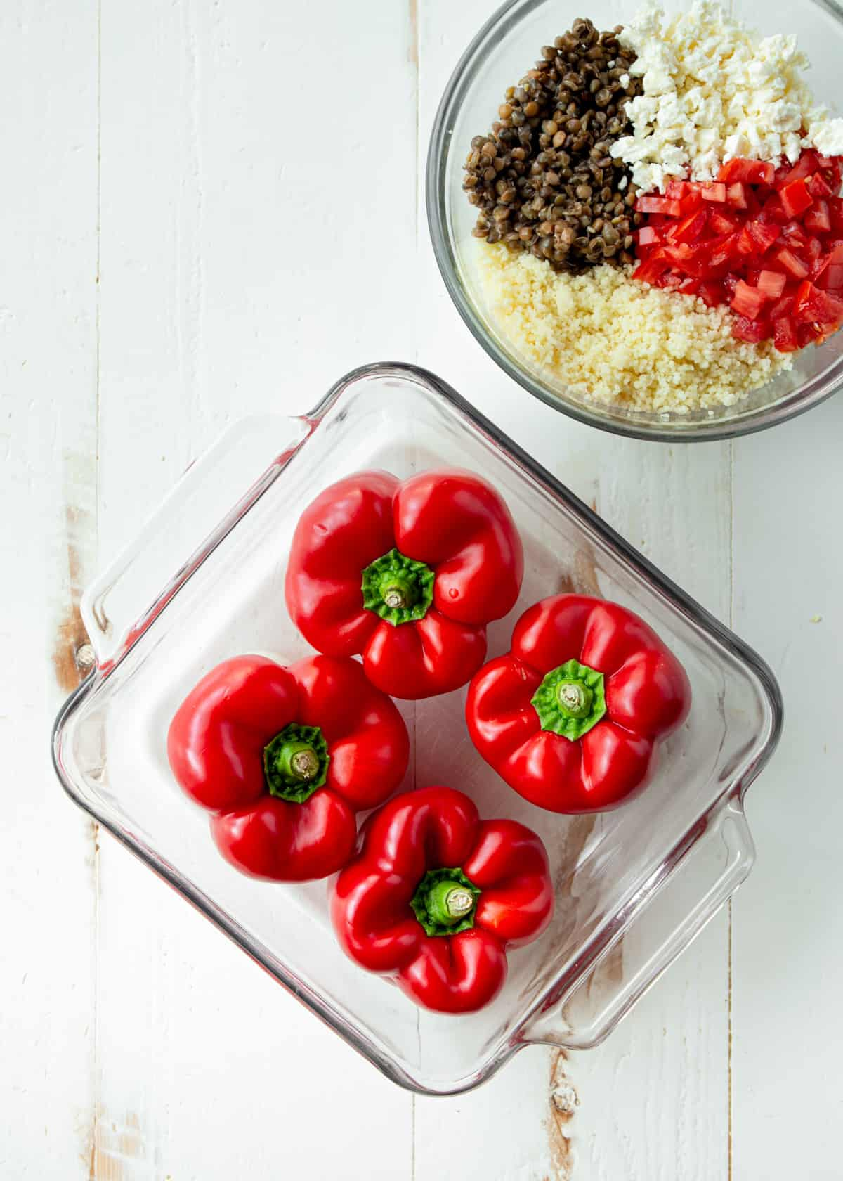 raw red peppers in a clear baking dish